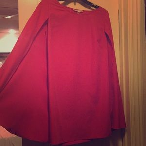 Knee length red dress with attached cape